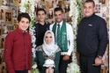 العروسان قررا إقامة جلسة تصوير  مستوحاه من اليوم الوطني السعودي