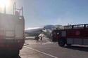 إخماد الحريق في مطار بكين