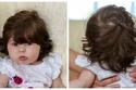 صور: ستعتقد أنها دمية.. طفلة رائعة بشعر طويل في عمر 5 شهور