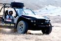 ملك الأردن أثناء مشاركته في أحد سباقات رالي السيارات مايو 2000