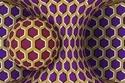 كرة في فجوة مع أشكال سداسية باللونين البنفسجي والقرمزي محاطة بأطر ذهبي
