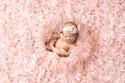 إيمي هيل مصورة تضيف الاسنان إلى صور الرضع