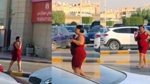 يكشف أكثر مما يغطي.. امرأة بفستان أحمر فاضح تثير الجدل في شوارع الرياض