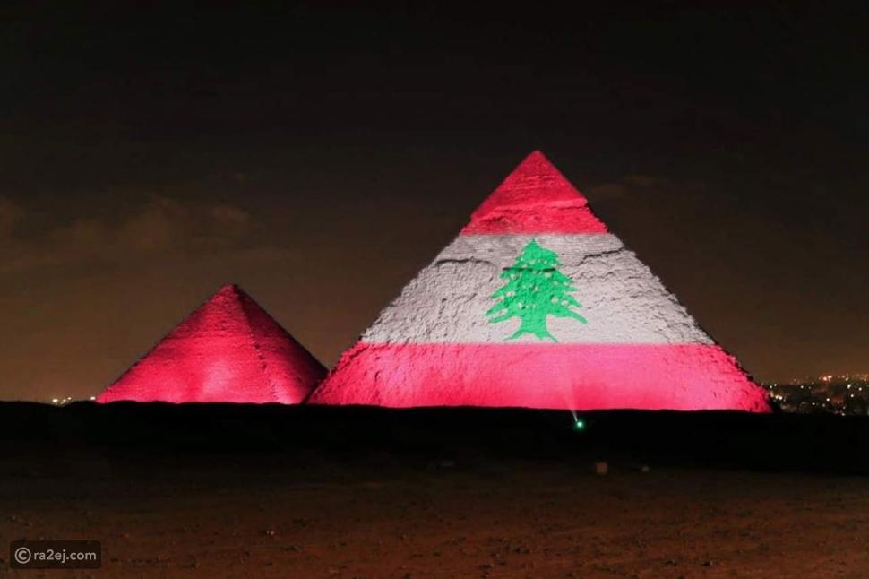 صور: برج خليفة والأهرامات يضيئان بألوان علم لبنان بعد الانفجار الأليم
